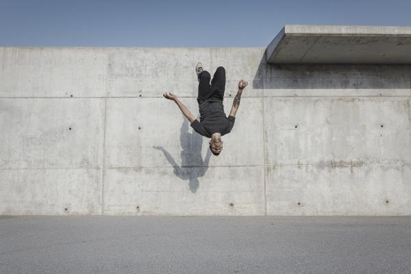 Talented gymnast backflips off wall
