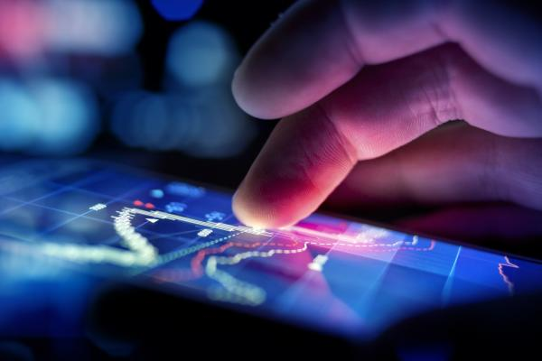 Finger on tablet device reviewing People Analytics trends