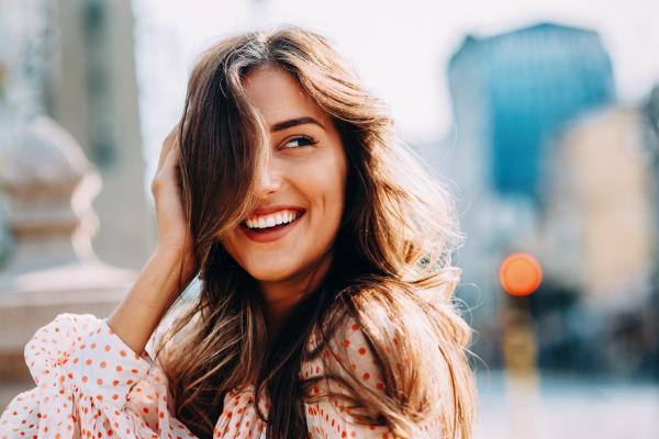 Smiling woman enjoys employment